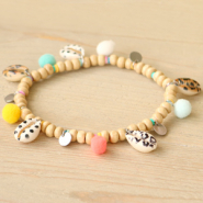 NEW New! Cowrie shells with print and coloured pompom charms