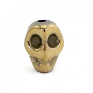 Hematite skull beads Antique gold