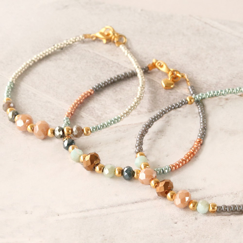 Colourful bracelets of faceted beads with golden details