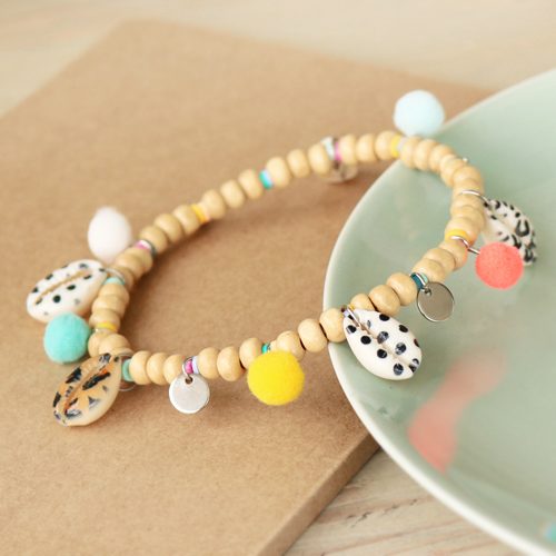 Check out how to make the best jewellery with Cowrie's and pompom charms: