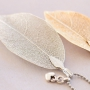 Delicate necklaces decorated with autumn leaf pendants