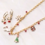 Cheerful Christmas jewellery with gold and silver Christmas charms