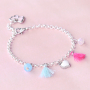 Girly jewellery with cheerful metal charms and soft colours