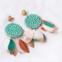 Festival jewellery inspiration with feathers and rattan pendants