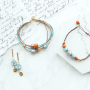 Amazing earrings and bracelets in warm colours made of new Polaris Elements beads