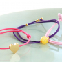 Need some inspiration? It's easy to make trendy bracelets out of elastic cord: