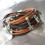 Work with layers like different kinds of round and braided DQ leather