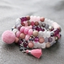 Trendy jewellery made of facet cut natural stone beads in pink and grey shades